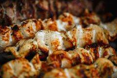 Grilled chicken meat on the grill close up, barbecue, shashlik, kebab, skewer on the grill Royalty Free Stock Image