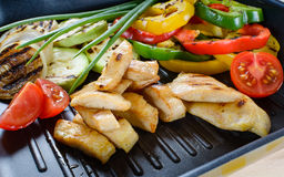 Grilled chicken meat on grill with vegetables Royalty Free Stock Photography