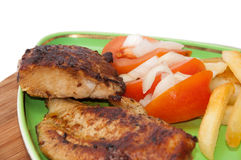 Grilled chicken meat with tomato salad Stock Photo
