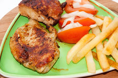 Grilled chicken meat with tomato salad Stock Photography