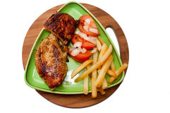 Grilled chicken meat with tomato salad Royalty Free Stock Photo