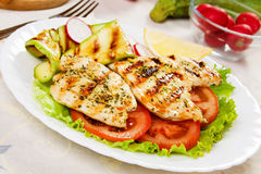 Grilled chicken meat with vegetables Stock Images