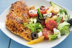 Grilled chicken with mediterranean salad Stock Photos