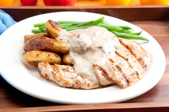 Grilled chicken with mushroom sauce and fingerling potatoes Stock Images