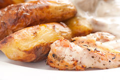Grilled chicken with mushroom sauce and fingerling potatoes Royalty Free Stock Image