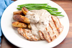grilled chicken with mushroom sauce and fingerling potatoes Stock Photography
