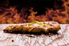 grilled chicken on a old wood table with background fire royalty free stock photos
