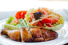 Grilled chicken and papaya salad, Thai food Stock Image