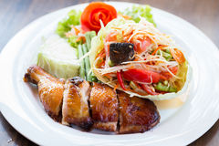 Grilled chicken and papaya salad, Thai food. In restaurant Royalty Free Stock Image