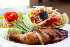 Grilled chicken and papaya salad, Thai food. In restaurant Royalty Free Stock Images