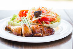 Grilled chicken and papaya salad, Thai food. In restaurant Royalty Free Stock Photo