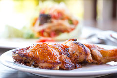 Grilled chicken and papaya salad, Thai food. In the white dish Stock Photos