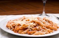 Grilled chicken pasta stock photos