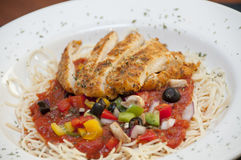 Grilled chicken pasta marinara Stock Photography
