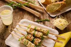 Grilled chicken and peppers on a skewer in picnic setting. Concept of barbecue picnic food. Barbecue grilled chicken and pepper kebab or souvlaki on skewer Royalty Free Stock Photos