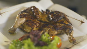 Grilled Chicken Plate in a restaurant, slow motion. Grilled Chicken Plate in a restaurant, close up stock video