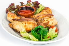 Grilled chicken on the plate with salad Royalty Free Stock Photos