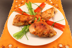 Grilled chicken on a plate on the table Stock Photos