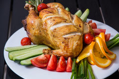 Grilled chicken on the plate Royalty Free Stock Images