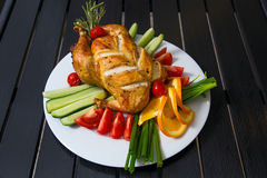 Grilled chicken on the plate Stock Image