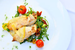Grilled chicken platter. Grilled chicken with vegetables in a restaurant, Hallstatt Stock Photos