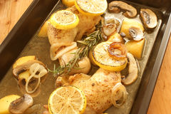 Grilled chicken with  potato and lemon Stock Image