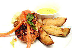 Grilled chicken with potato wedges isolated Stock Photo