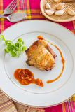 Grilled chicken with red sauce and garlic. Stock Photo