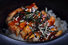 Grilled Chicken and Rice on black bowl Royalty Free Stock Photos