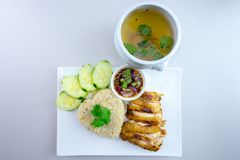 Grilled chicken with rice Thai style. Grilled chicken with rice is a dish adapted from early Chinese immigrants originally from Hainan province in southern China Royalty Free Stock Photography