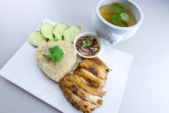 Grilled chicken with rice Thai style. Grilled chicken with rice is a dish adapted from early Chinese immigrants originally from Hainan province in southern China Stock Photo