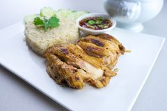 Grilled chicken with rice Thai style. Grilled chicken with rice is a dish adapted from early Chinese immigrants originally from Hainan province in southern China Stock Image