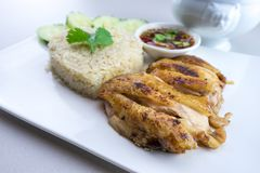 Grilled chicken with rice Thai style. Grilled chicken with rice is a dish adapted from early Chinese immigrants originally from Hainan province in southern China Stock Photography