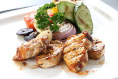 Grilled chicken with roasted vegetables on white dish Stock Photography