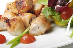 Grilled chicken and salad. On white plate Royalty Free Stock Photography
