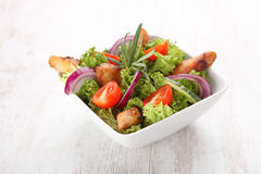 Grilled chicken salad. In white bow Royalty Free Stock Photo