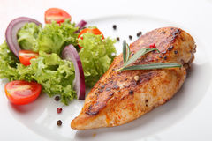 Grilled chicken salad. Grilled chicken and salad on wooden table Stock Images