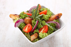 Grilled chicken salad. In bowl Royalty Free Stock Photos