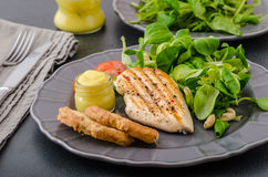 Grilled chicken with salad and nuts Stock Image