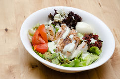 Grilled chicken salad with tomato, potato, onion Stock Photo