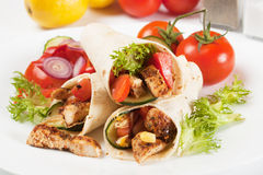 Grilled chicken and salad in tortilla wrap. Grilled chicken meat and vegetable salad in tortilla wrap Royalty Free Stock Image