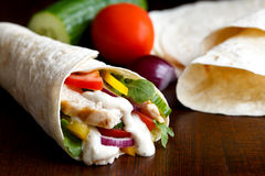 Grilled chicken and salad tortilla wrap with white sauce isolate Stock Photography