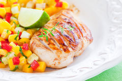 Grilled chicken and salsa Stock Photo