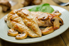 Grilled Chicken with Sauteed Mushrooms. A boneless, skinless, grilled chicken breast with sauteed mushrooms Stock Images