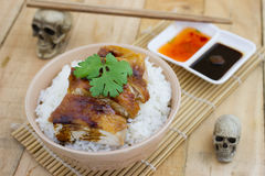 Grilled chicken serve on rice with sauce Stock Photo