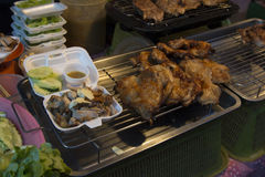 Grilled chicken. Served in small plastic contaner on the street Stock Photography