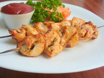 Grilled chicken on a skewer Stock Images