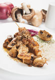 Grilled chicken skewer with mushrooms and rice Royalty Free Stock Photo