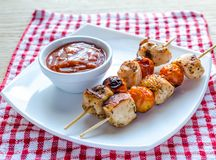 Grilled chicken skewers with cherry tomatoes Royalty Free Stock Image