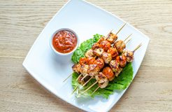 Grilled chicken skewers with cherry tomatoes Stock Photo